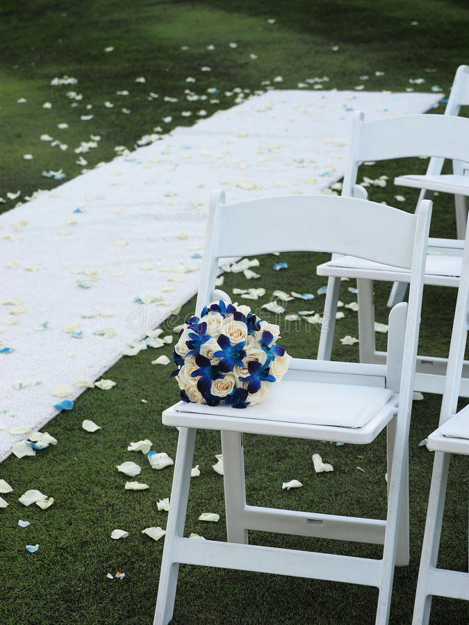 Wedding seats and bouquet stock image