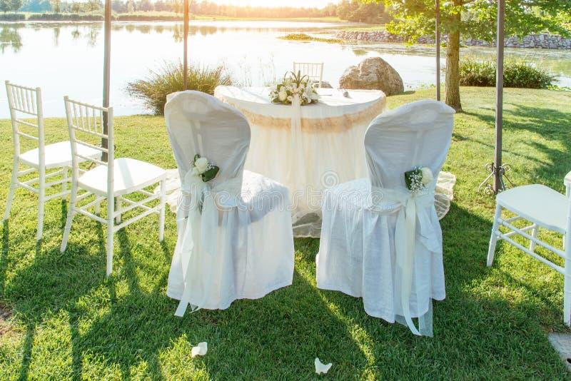 Wedding seats into sunlight stock image