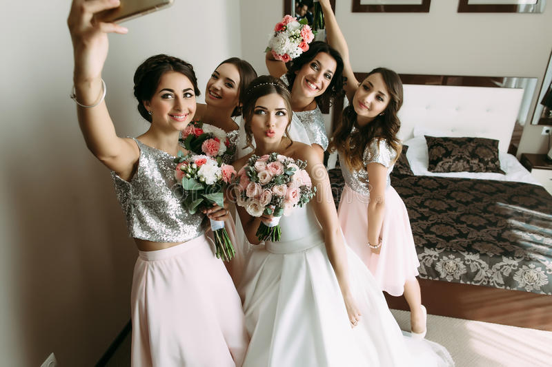 Wedding selfie of a bride and her bridesmaids. A royalty free stock image