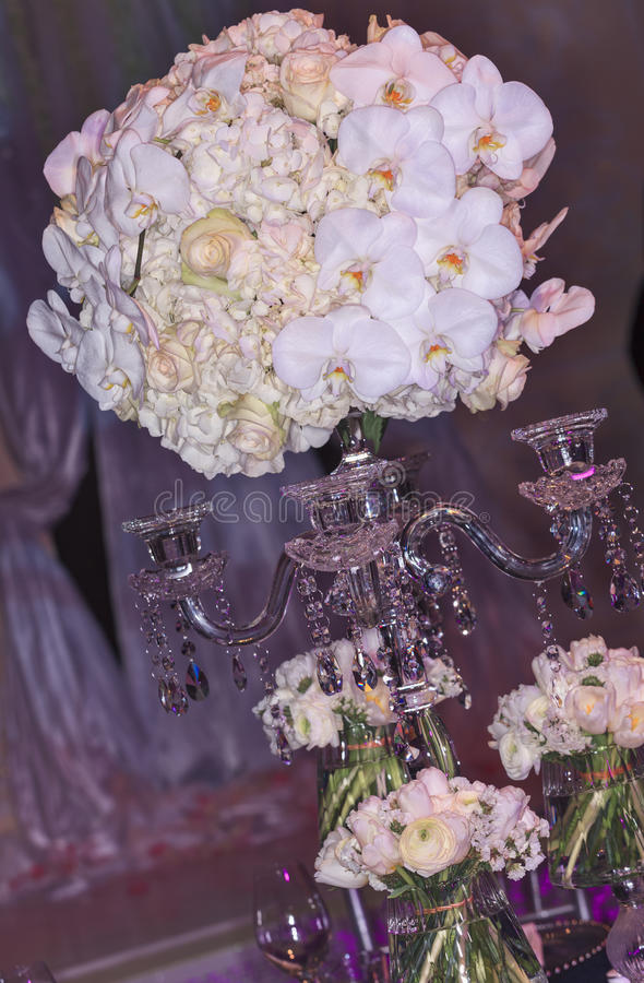 Wedding set-up. Wedding decoration setup. Roses and orchids bouquet with candelabra. Small bouquets in glasses around stock photography