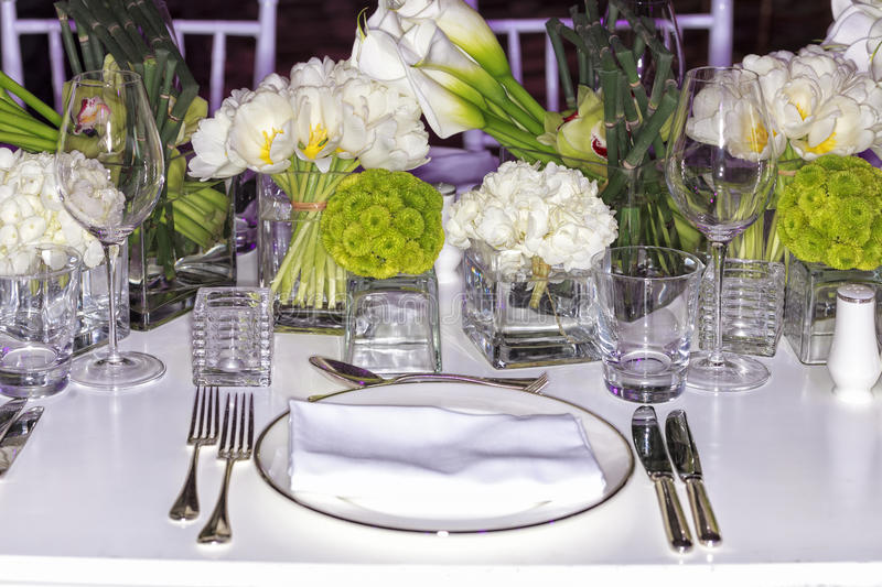 Wedding set-up. Wedding dinner setup. Beautiful flowers decoration for wedding dinner with combination of white and light green bouquets stock photo