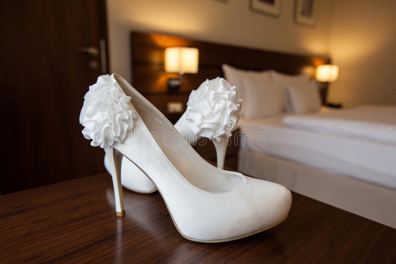 Wedding shoes. White wedding sandals in detail stock photos