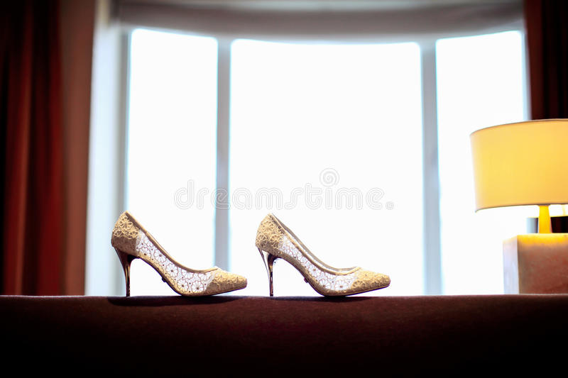 Wedding shoes. Infront of window stock photo