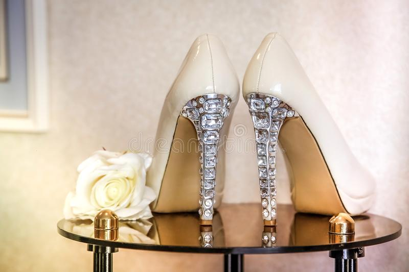 Wedding shoes beige high-heeled decorated with precious stones. Wedding shoes with high heels decorated with jewelry made of stones royalty free stock photography