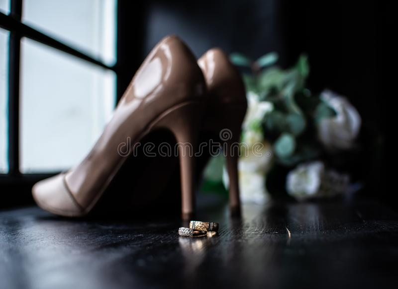 Wedding shoes and wedding bouquet, wedding gold rings stock images