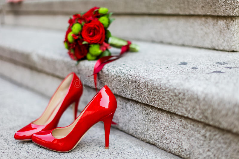 Wedding. Shoes and the bouquet on the stairs stock photos