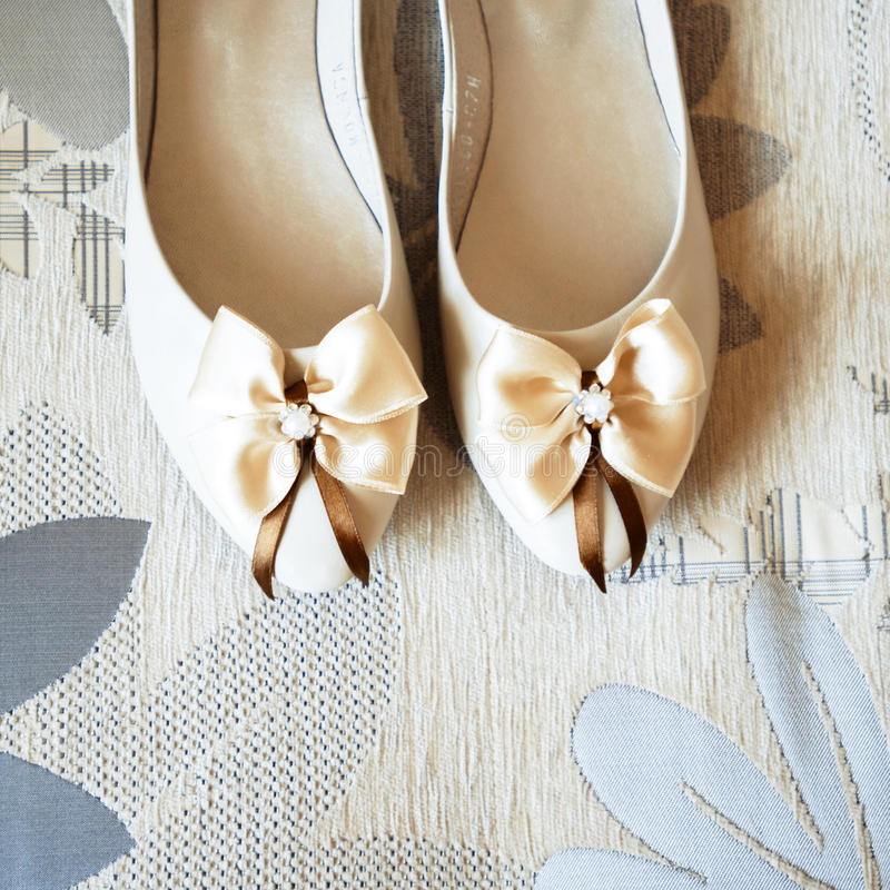 Wedding shoes with a bow. Bridesmaid dress element royalty free stock images