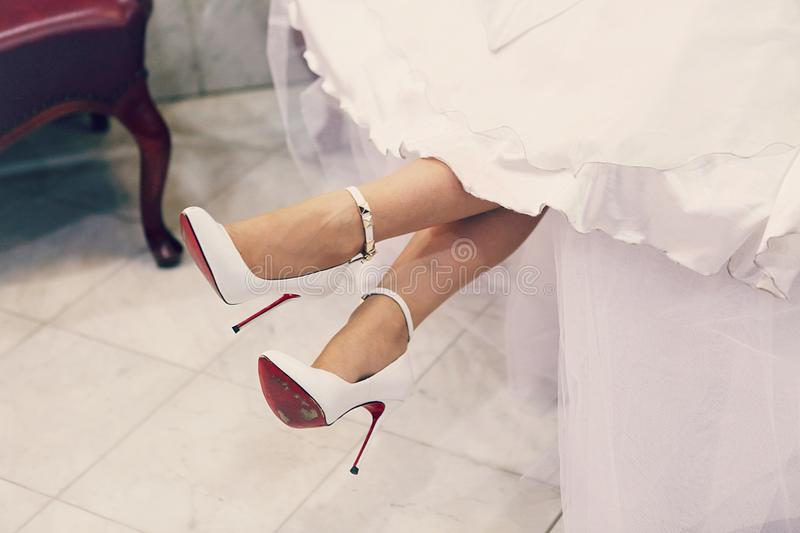 Wedding shoes. Of the bride royalty free stock photo