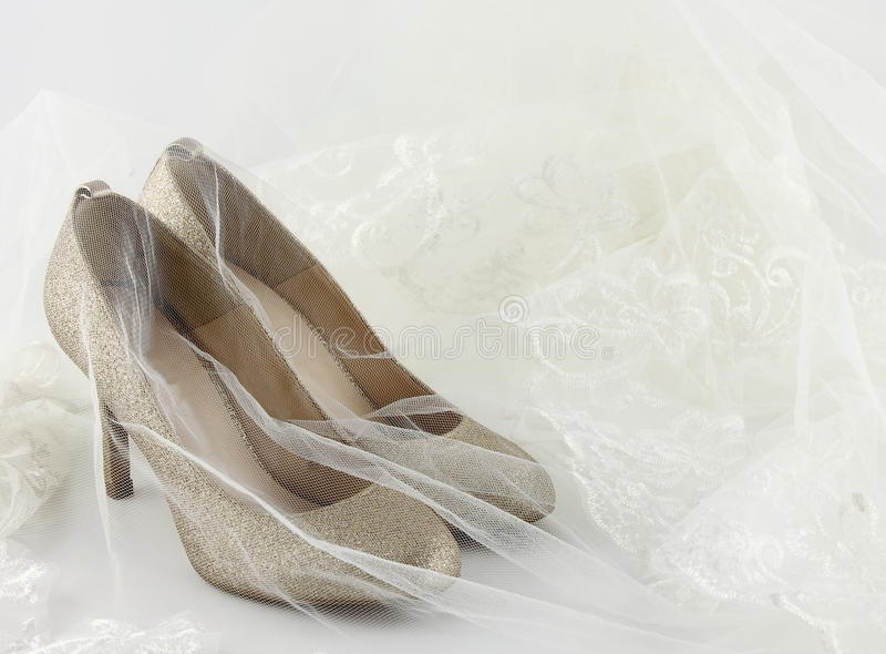 Wedding shoes and a bride veil stock photos