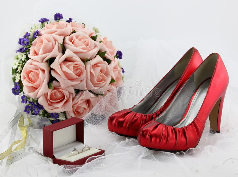 Wedding shoes and a bride veil and a wedding ring royalty free stock image