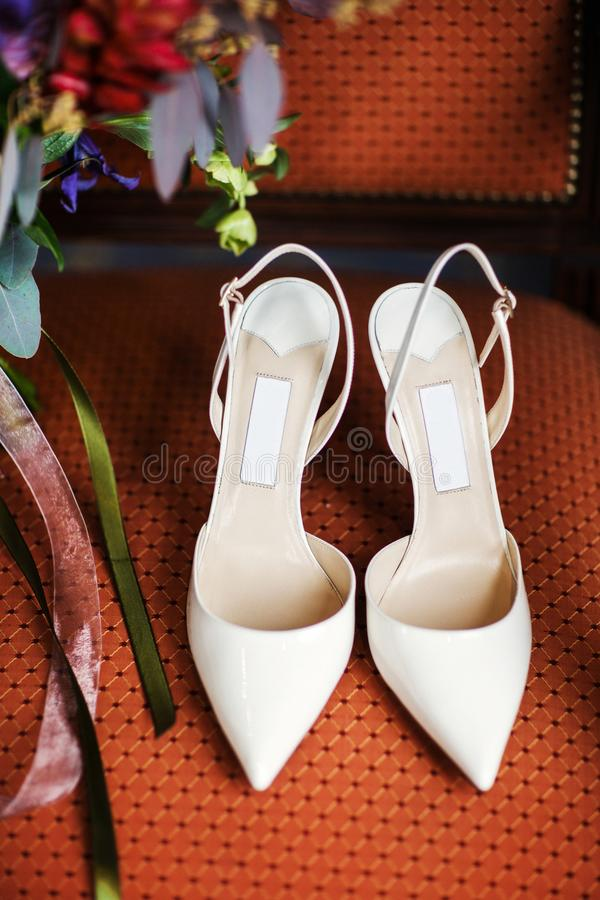 Wedding shoes on the chair. Wedding preparation royalty free stock image
