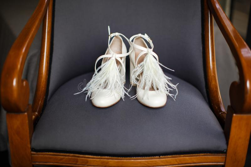 Wedding shoes on the chair. Wedding shoes on the wooden chair. Wedding preparation stock images