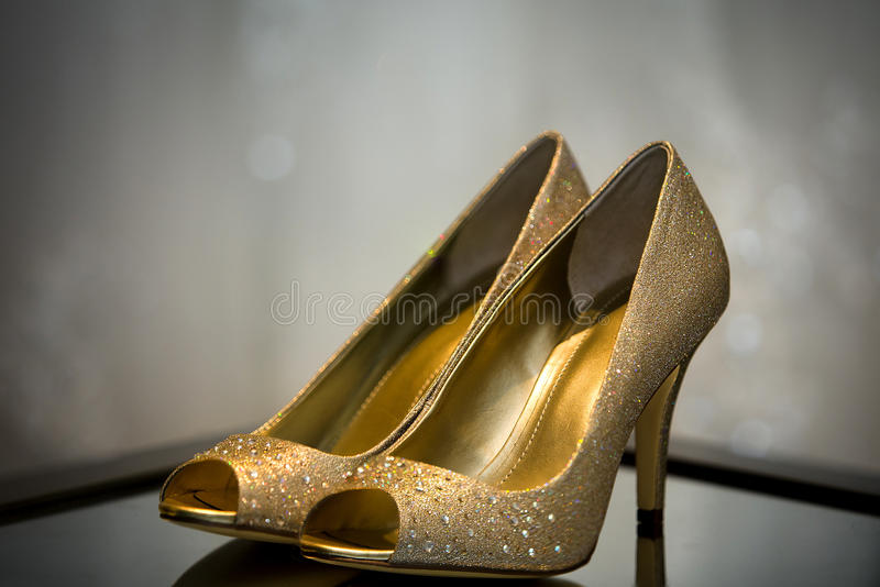 Wedding Shoes. Close up of bridal wedding shoes during pre ceremony preparations royalty free stock photo