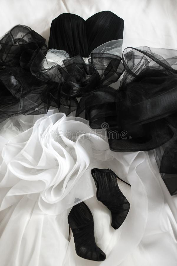 Wedding shoes and wedding dress on the bed stock image