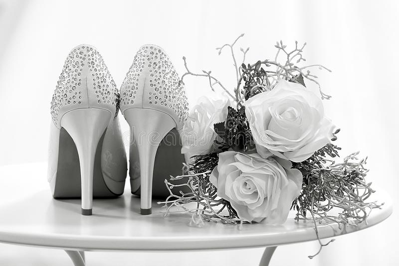 Wedding shoes and flowers on a table black and white stock photo download wedding shoes and flowers on a table black and white stock photo image of mightylinksfo