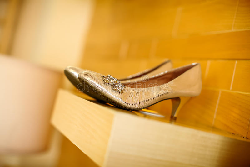 Wedding shoes. In front of the wall stock photos