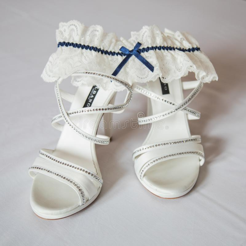 Wedding Shoes and garter stock images