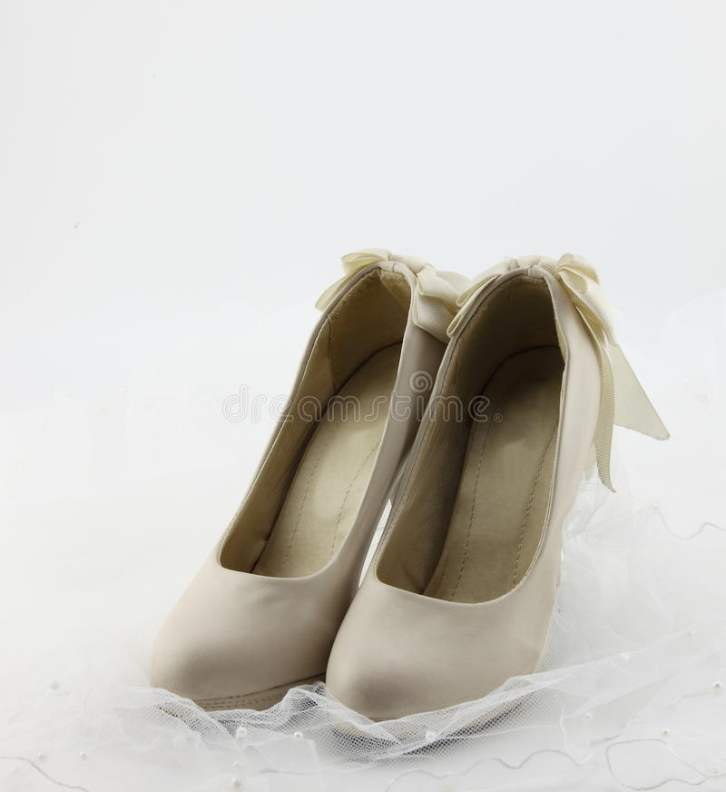 Wedding shoes. This graph is a pair of rice white wedding shoes royalty free stock photo