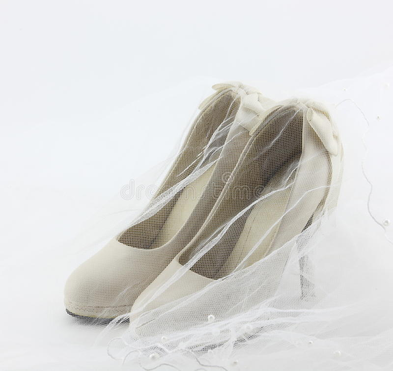 Wedding shoes. This graph is a pair of rice white wedding shoes stock image