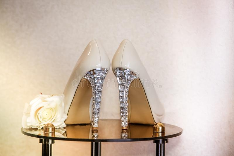 Wedding shoes with high heels decorated with jewelry made of stones stock image