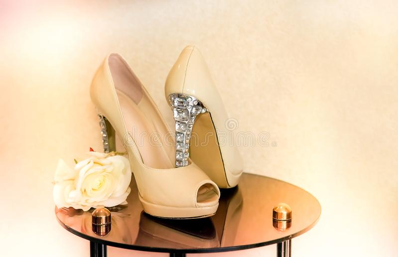 Wedding shoes with high heels are on the mirror table royalty free stock photos
