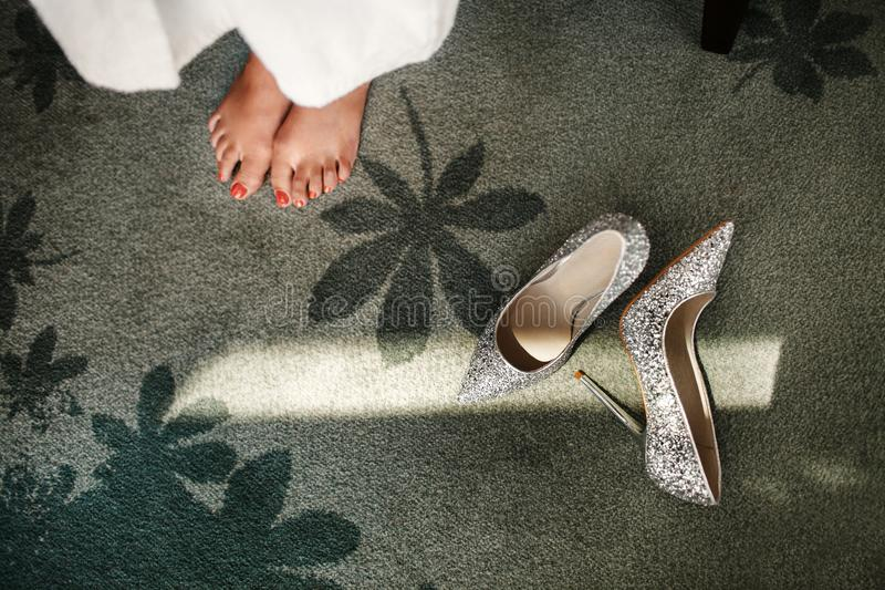 Wedding shoes and legs of the bride.  stock image