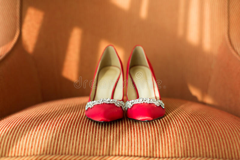 Wedding shoes. On a sofa royalty free stock images