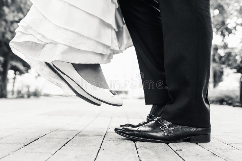 Wedding shoes in standing and flying of couple. Wedding shoes in a standing bride and groom. retro vintage photo stock images