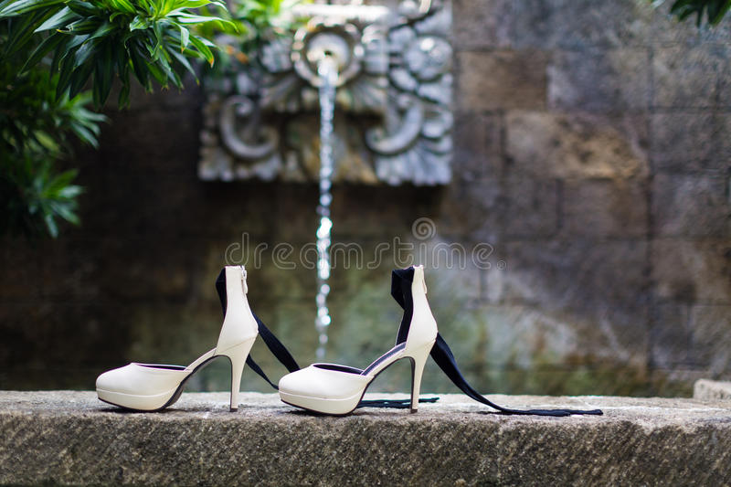 Wedding shoes. On the stone stock photo
