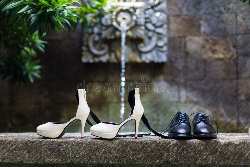 Wedding shoes. On the stone stock photos