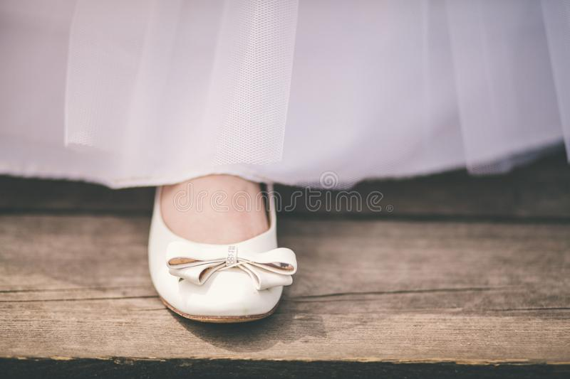 Wedding shoes with sweep of a bride royalty free stock image