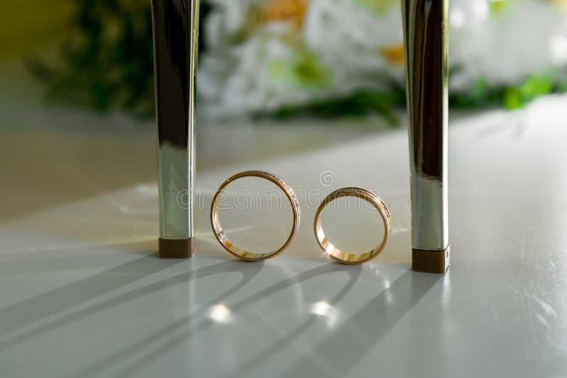 Wedding shoes and wedding rings among them.  stock photo
