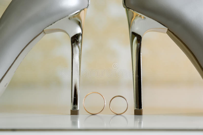 Wedding shoes and wedding rings among them.  stock photos