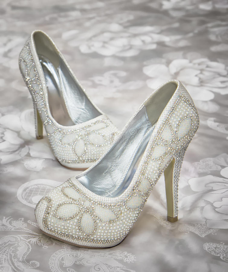 Wedding shoes. Wedding white shoes. Photo taken on: August 29, 2015 royalty free stock photography