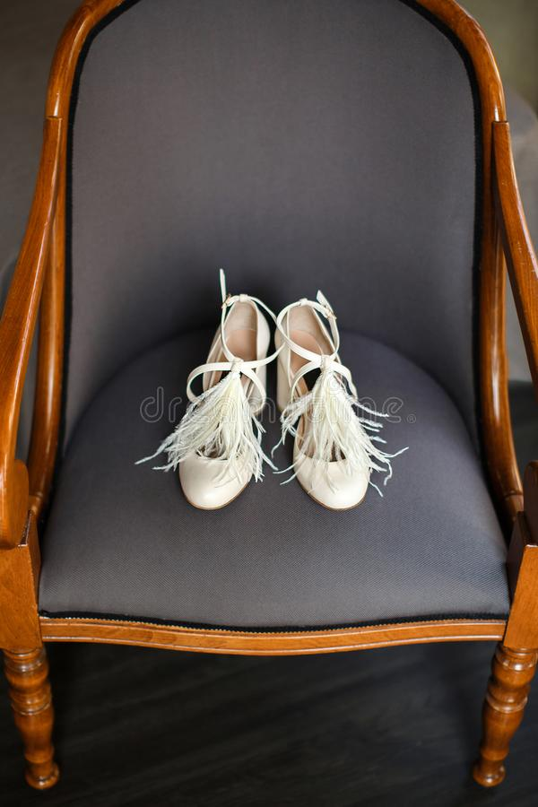 Wedding shoes on the chair. Wedding shoes on the wooden chair. Wedding preparation royalty free stock photography