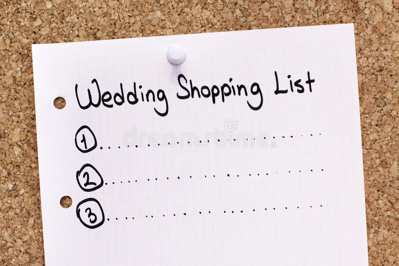 Wedding Shopping List. Pink wedding shopping list pinned on cork noticeboard royalty free stock photography