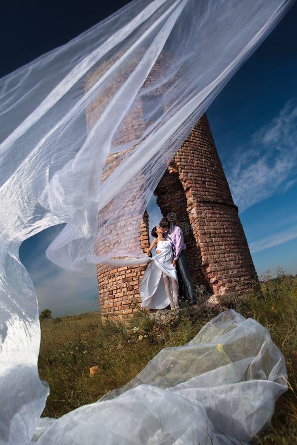 Wedding Shot Against Abandoned Ruins Stock Photo