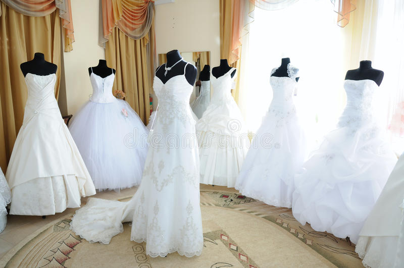Wedding showroom. Wedding dresses on dummies in the showroom stock photo