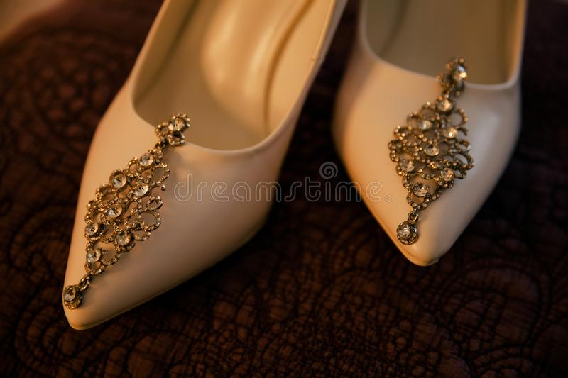 Earrings are on the bright shoes royalty free stock photos