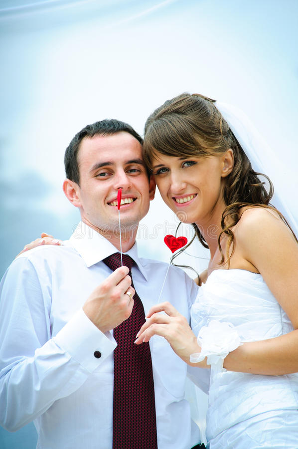 Wedding smile couple with red heart