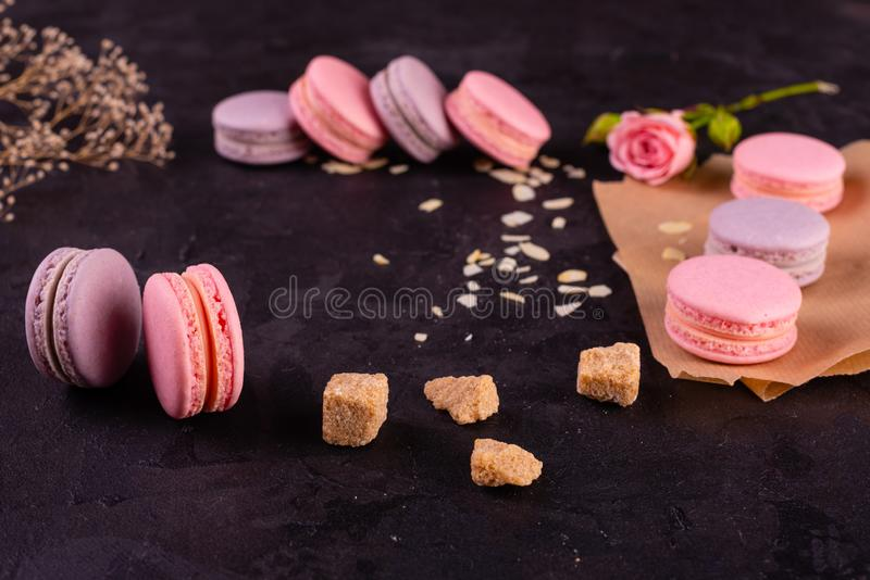 Wedding, St. Valentine`s Day, birthday, preparation, holiday. Beautiful pink tasty macarons. On a concrete background royalty free stock photos