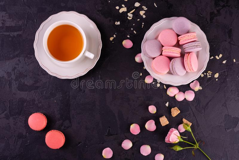 Wedding, St. Valentine`s Day, birthday, preparation, holiday. Beautiful pink tasty macarons. On a concrete background royalty free stock photography