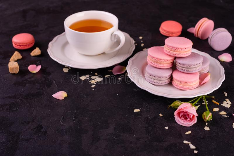Wedding, St. Valentine`s Day, birthday, preparation, holiday. Beautiful pink tasty macarons. On a concrete background stock image