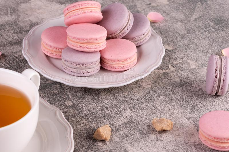 Wedding, St. Valentine`s Day, birthday, preparation, holiday. Beautiful pink tasty macarons. On a concrete background stock photos
