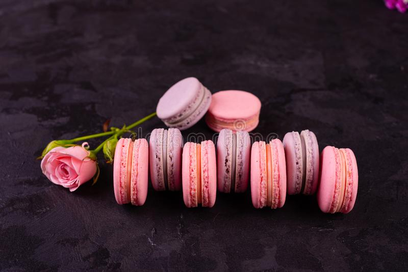 Wedding, St. Valentine`s Day, birthday, preparation, holiday. Beautiful pink tasty macarons. On a concrete background royalty free stock photo