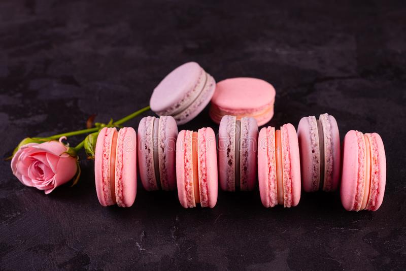 Wedding, St. Valentine`s Day, birthday, preparation, holiday. Beautiful pink tasty macarons. On a concrete background royalty free stock image