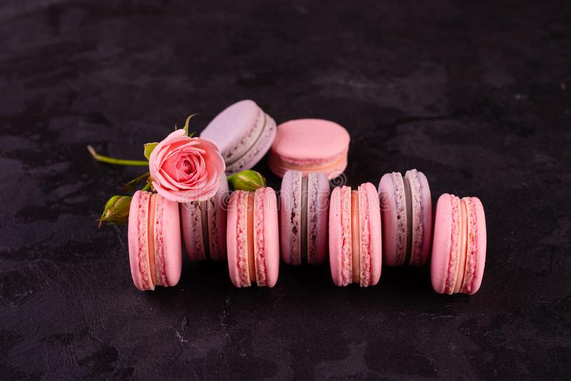 Wedding, St. Valentine`s Day, birthday, preparation, holiday. Beautiful pink tasty macarons. On a concrete background stock images