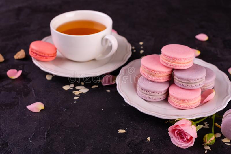 Wedding, St. Valentine`s Day, birthday, preparation, holiday. Beautiful pink tasty macarons. On a concrete background stock photo