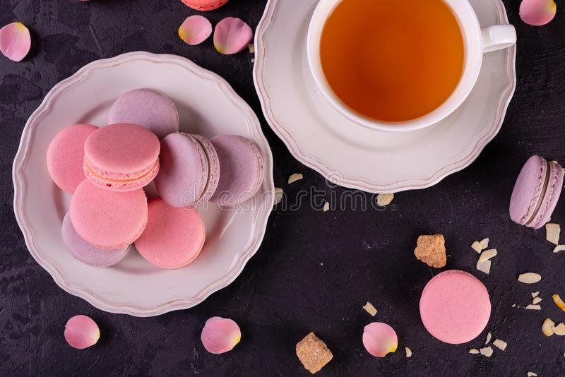 Wedding, St. Valentine`s Day, birthday, preparation, holiday. Beautiful pink tasty macarons. On a concrete background stock photography