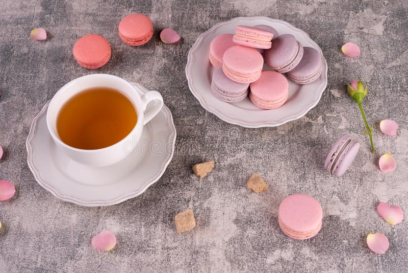 Wedding, St. Valentine`s Day, birthday, preparation, holiday. Beautiful pink tasty macarons. On a concrete background royalty free stock images